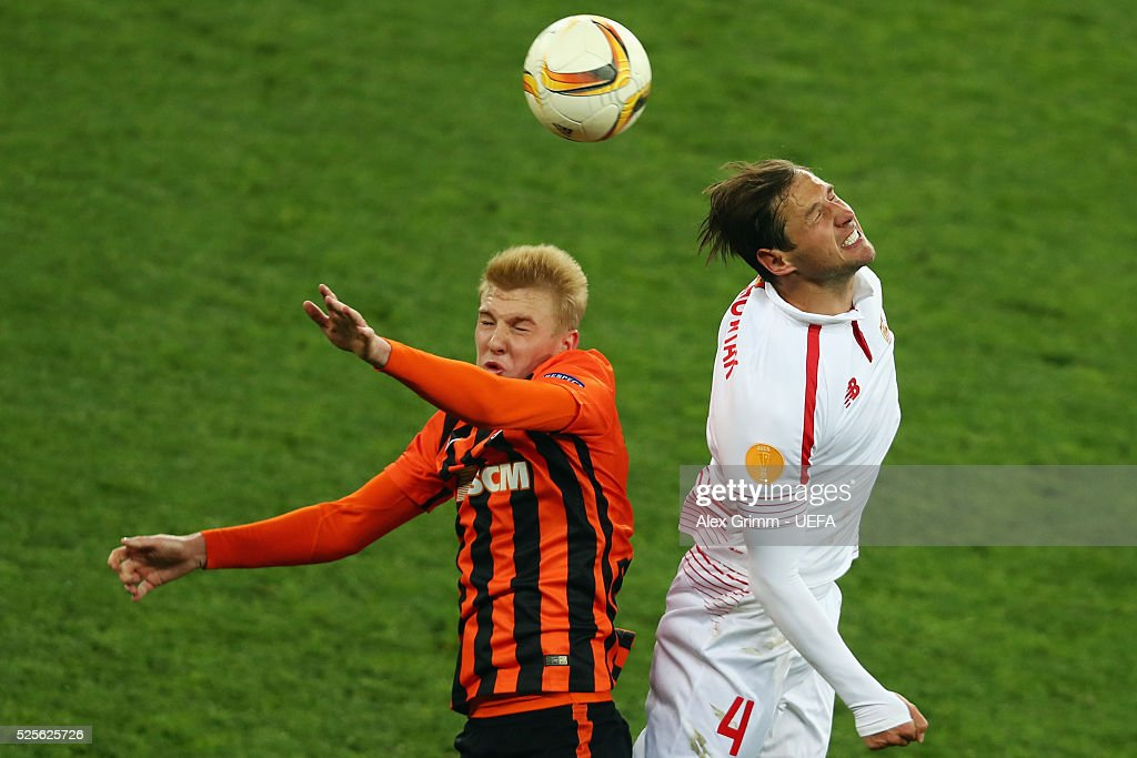 Viktor Kovalenko (L) of Shakhtar jumps for a header with Grzegorz Krychowiak of Sevilla during the UEFA Europa League Semi Final first leg match between Shakhtar Donetsk and Sevilla at Arena Lviv on April 28, 2016 in Lviv, Ukraine.