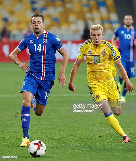 Viktor Kovalenko of Ukraine in action against Kari Arnason of Iceland during the 2018 FIFA World Cup Qualifying match between Ukraine and Iceland at...