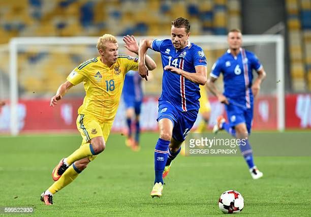 Viktor Kovalenko of Ukraine vies with Kari Arnason of Iceland during the World Cup 2018 qualifier football match Ukraine vs Iceland at Olimpiyskiy...