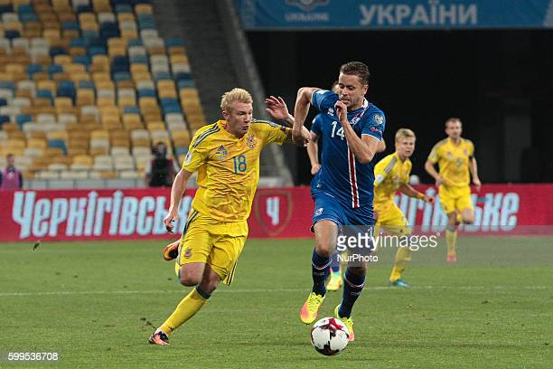 Viktor Kovalenko of Ukraine vies with Kari Arnason of Iceland during the FIFA World Cup 2018 qualifying soccer match between Ukraine and Iceland...