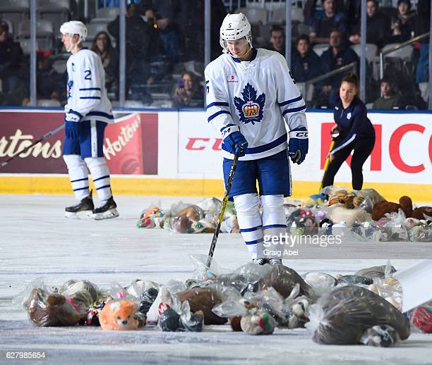 Viktor Loov of the Toronto Marlies helps collect the stuffed toys during the Marlies annual Teddy Bear Toss game on December 3 2016 at Ricoh Coliseum...