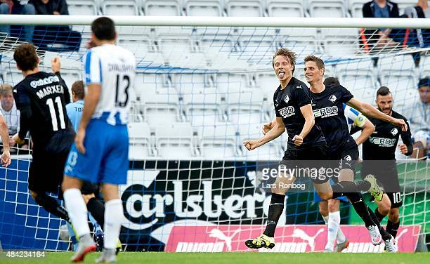 Viktor Lundberg of Randers FC celebrates after scoring their third goal during the Danish Alka Superliga match between OB Odense and Randers FC at...