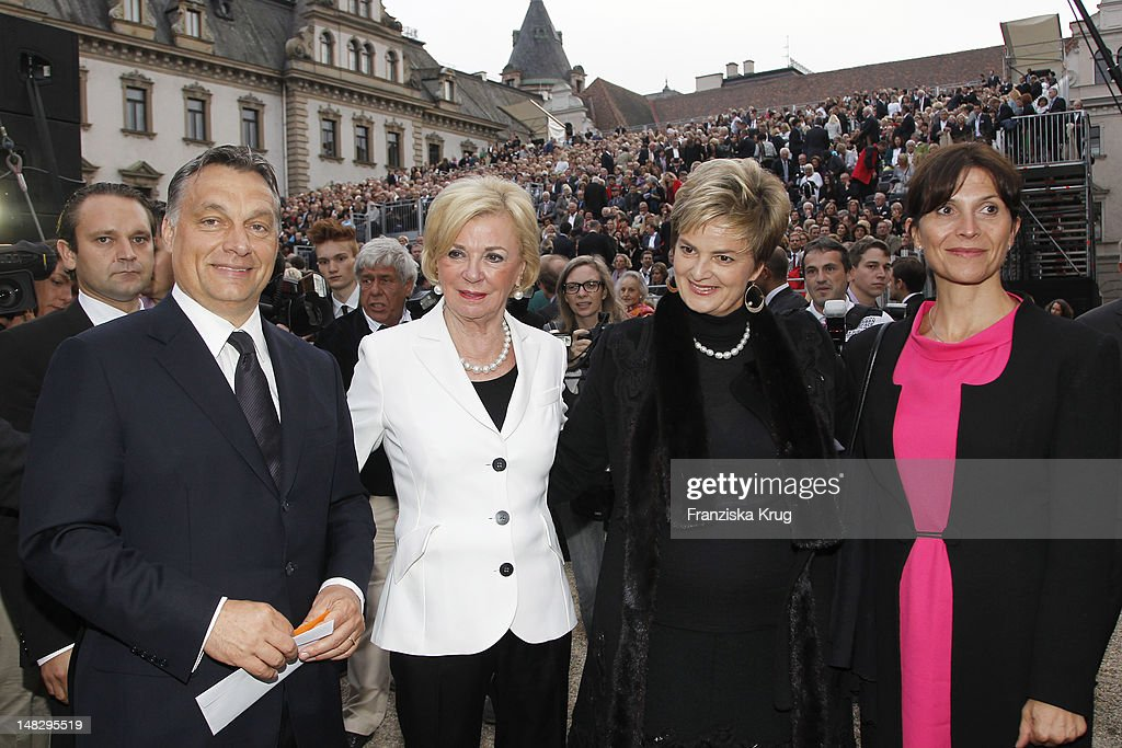<a gi-track='captionPersonalityLinkClicked' href=/galleries/search?phrase=Viktor+Orban&family=editorial&specificpeople=4685765 ng-click='$event.stopPropagation()'>Viktor Orban</a> and <a gi-track='captionPersonalityLinkClicked' href=/galleries/search?phrase=Liz+Mohn&family=editorial&specificpeople=608012 ng-click='$event.stopPropagation()'>Liz Mohn</a> and <a gi-track='captionPersonalityLinkClicked' href=/galleries/search?phrase=Gloria+von+Thurn+und+Taxis&family=editorial&specificpeople=2920313 ng-click='$event.stopPropagation()'>Gloria von Thurn und Taxis</a> and Aniko Levai attend the opera 'The Magic Flute' (Die Zauberfloete) at the Thurn & Taxis Castle Festival Opening on July 13, 2012 in Regensburg, Germany.
