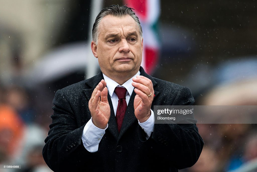 <a gi-track='captionPersonalityLinkClicked' href=/galleries/search?phrase=Viktor+Orban&family=editorial&specificpeople=4685765 ng-click='$event.stopPropagation()'>Viktor Orban</a>, Hungary's prime minister, applauds during an official address, outside the National Museum of Hungary in Budapest, Hungary, on Tuesday, March 15, 2016. Hungary won't allow the European Union to force member states to accept refugees, Orban said. Photographer: Akos Stiller/Bloomberg via Getty Images