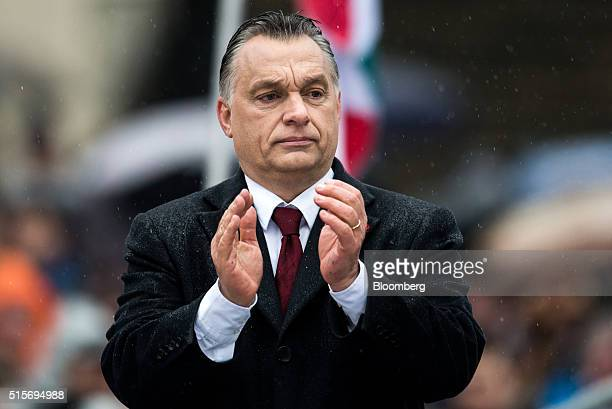 Viktor Orban Hungary's prime minister applauds during an official address outside the National Museum of Hungary in Budapest Hungary on Tuesday March...