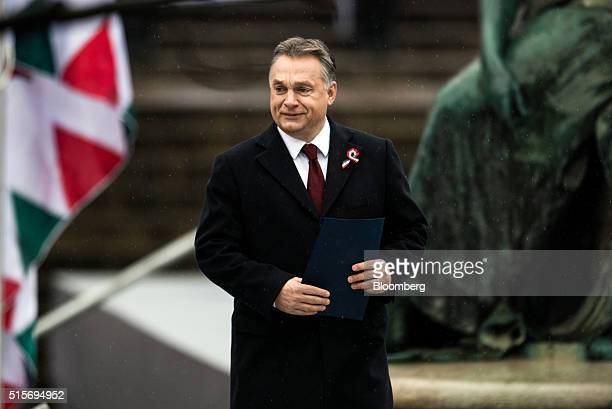 Viktor Orban Hungary's prime minister arrives for an official address outside the National Museum of Hungary in Budapest Hungary on Tuesday March 15...