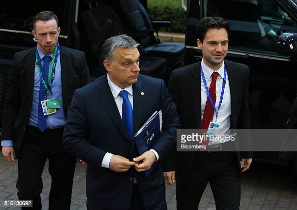 Viktor Orban Hungary's prime minister center arrives for a meeting with European Union leaders in Brussels Belgium on Thursday March 17 2016 Turkey...