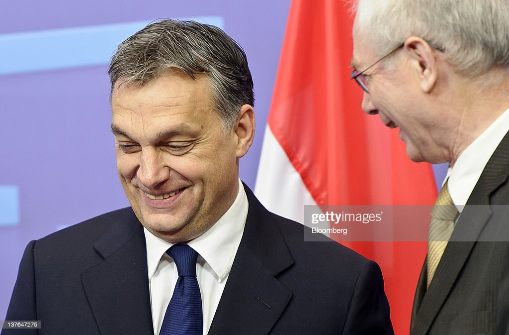 <a gi-track='captionPersonalityLinkClicked' href=/galleries/search?phrase=Viktor+Orban&family=editorial&specificpeople=4685765 ng-click='$event.stopPropagation()'>Viktor Orban</a>, Hungary's prime minister, left, reacts as he arrives for a meeting with <a gi-track='captionPersonalityLinkClicked' href=/galleries/search?phrase=Herman+Van+Rompuy&family=editorial&specificpeople=4476281 ng-click='$event.stopPropagation()'>Herman Van Rompuy</a>, president of the European Union (EU), at the European Council headquarters in Brussels, Belgium, on Tuesday, Jan. 24, 2012. Hungary unexpectedly left the European Union's highest benchmark interest rate unchanged as local assets rebounded from record lows after Orban said he would yield in a row with the European Union. Photographer: Jock Fistick/Bloomberg via Getty Images