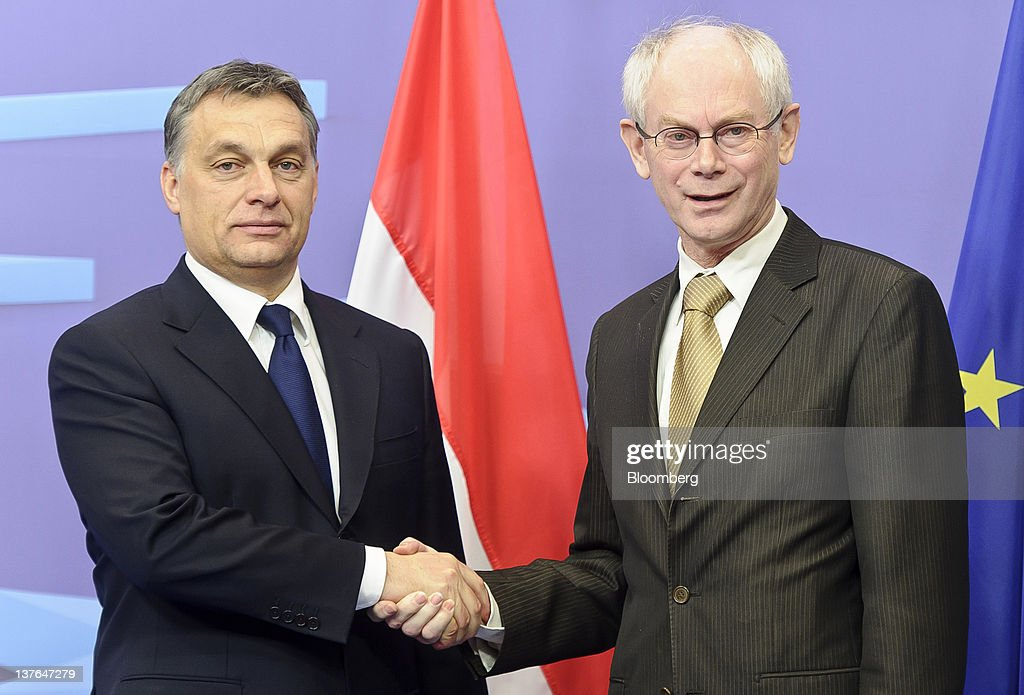 Viktor Orban, Hungary's prime minister, left, shakes hands with Herman Van Rompuy, president of the European Union (EU), ahead of their meeting at the European Council headquarters in Brussels, Belgium, on Tuesday, Jan. 24, 2012. Hungary unexpectedly left the European Union's highest benchmark interest rate unchanged as local assets rebounded from record lows after Orban said he would yield in a row with the European Union. Photographer: Jock Fistick/Bloomberg via Getty Images