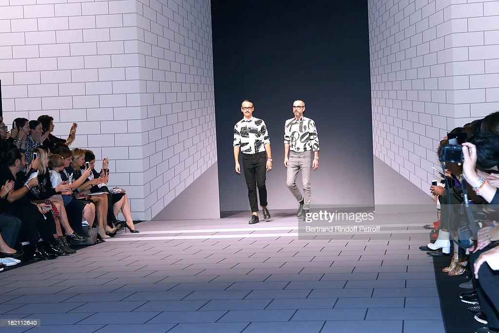 Viktor & Rolf walk the runwayat the end of their show as part of the Paris Fashion Week Womenswear Spring/Summer 2014, held at ephemeral space in Jardin des Tuileries on September 28, 2013 in Paris, France.