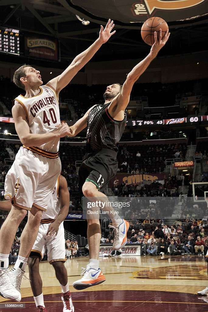 Viktor Sanikidze #13 of the Montepaschi Siena goes to the basket against <a gi-track='captionPersonalityLinkClicked' href=/galleries/search?phrase=Tyler+Zeller&family=editorial&specificpeople=5122156 ng-click='$event.stopPropagation()'>Tyler Zeller</a> #40 of the Cleveland Cavaliers during the game between the Montepaschi Siena and the Cleveland Cavaliers at The Quicken Loans Arena on October 8, 2012 in Cleveland, Ohio.