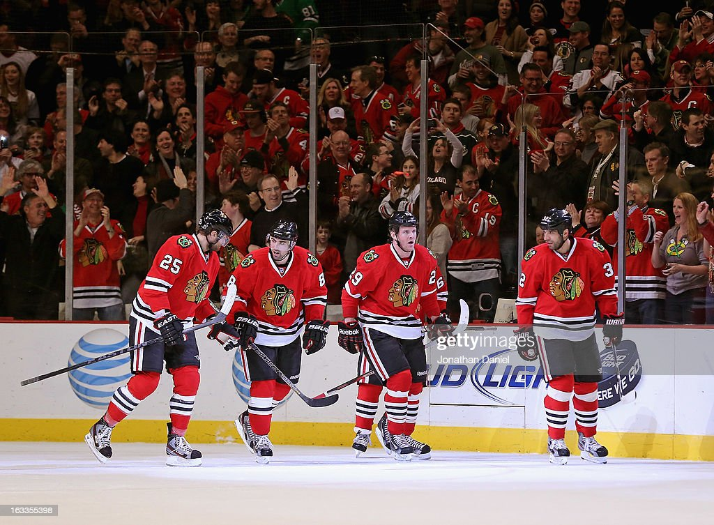 Viktor Stalberg #25, Nick Leddy #8, Bryan Bickell #29, Andrew Shaw #65 and Michal Rozsival #32 of the Chicago Blackhawks celebrate a goal against the Minnesota Wild at the United Center on March 5, 2013 in Chicago, Illinois. The Blackhawks defeated the Wild 5-3.