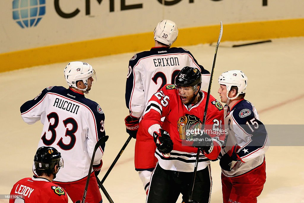Viktor Stalberg #25 of the Chicago Blackhawks celebrates a goal between Adrain Aucoin #33, Tim Erixon #20 and Derek Dorsett #15 of the Columbus Blue Jackets at the United Center on March 1, 2013 in Chicago, Illinois. The Blackhawks defeated the Blue Jackets 4-3 in overtime.