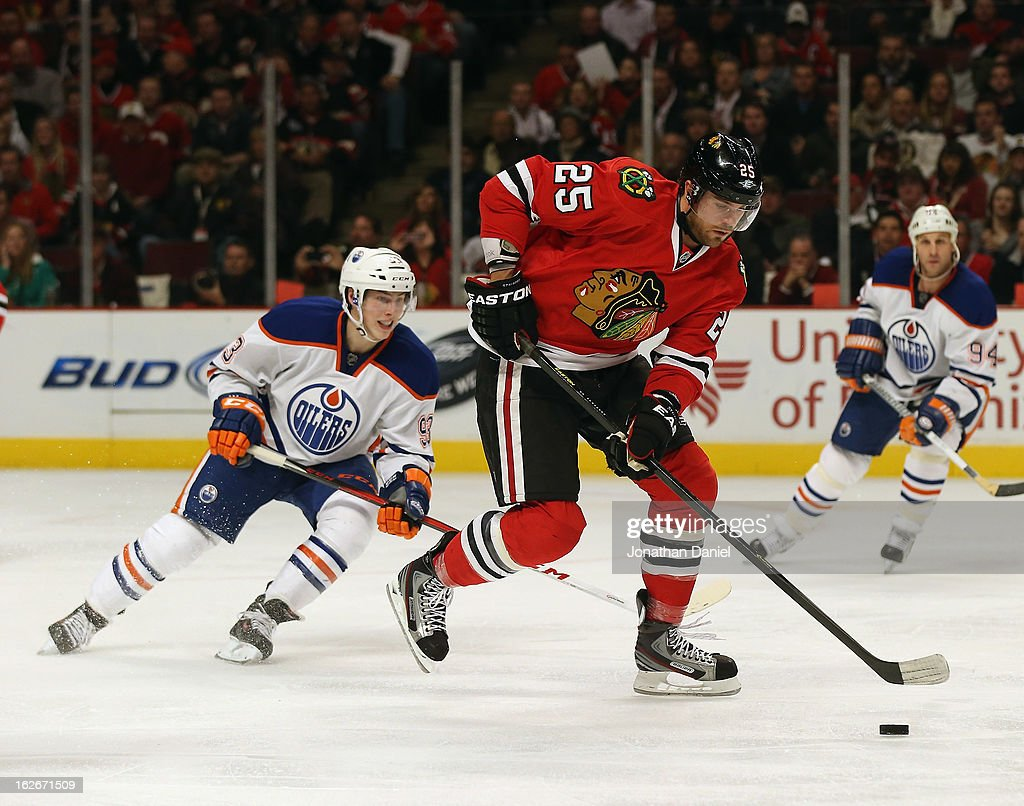 <a gi-track='captionPersonalityLinkClicked' href=/galleries/search?phrase=Viktor+Stalberg&family=editorial&specificpeople=5802237 ng-click='$event.stopPropagation()'>Viktor Stalberg</a> #25 of the Chicago Blackhawks controls the puck in front of <a gi-track='captionPersonalityLinkClicked' href=/galleries/search?phrase=Ryan+Nugent-Hopkins&family=editorial&specificpeople=7144190 ng-click='$event.stopPropagation()'>Ryan Nugent-Hopkins</a> #93 of the Edmonton Oilers at the United Center on February 25, 2013 in Chicago, Illinois. The Blackhawks defeated the Oilers 3-2 in overtime.