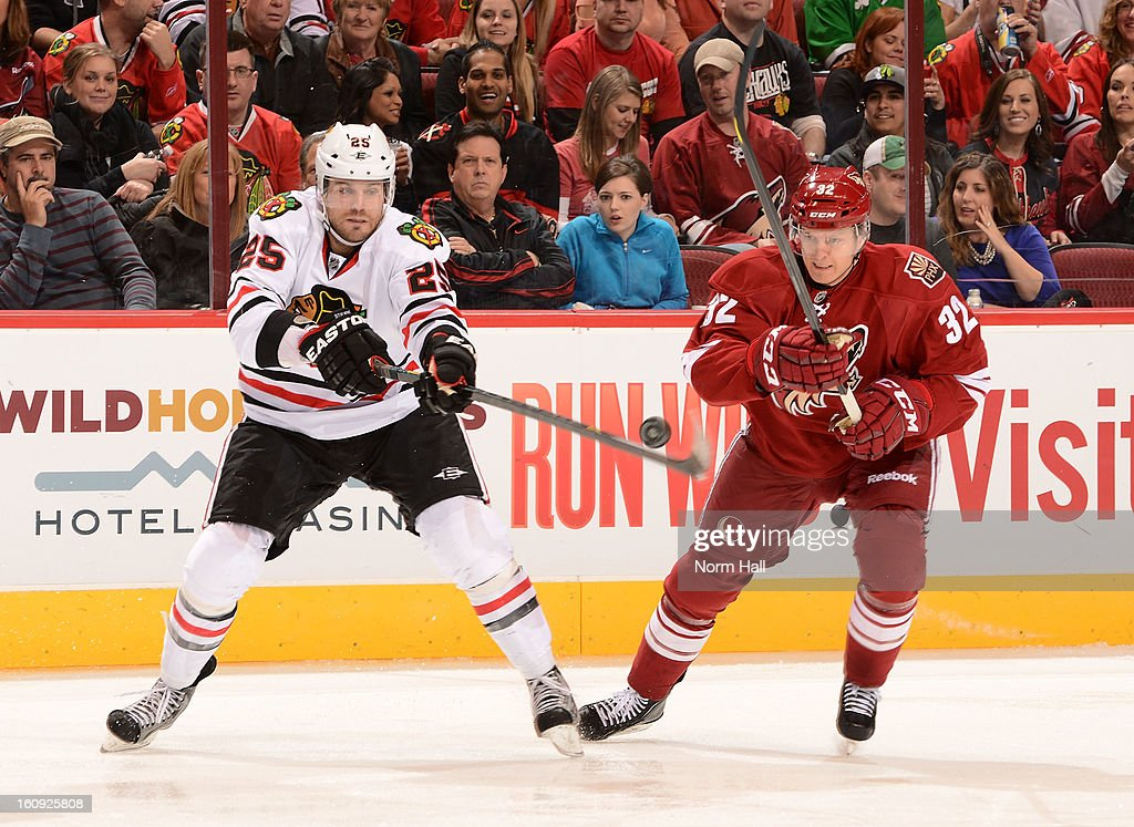 <a gi-track='captionPersonalityLinkClicked' href=/galleries/search?phrase=Viktor+Stalberg&family=editorial&specificpeople=5802237 ng-click='$event.stopPropagation()'>Viktor Stalberg</a> #25 of the Chicago Blackhawks plays the puck in the air in front of Nick Johnson #32 of the Phoenix Coyotes during the third period at Jobing.com Arena on February 7, 2013 in Glendale, Arizona.