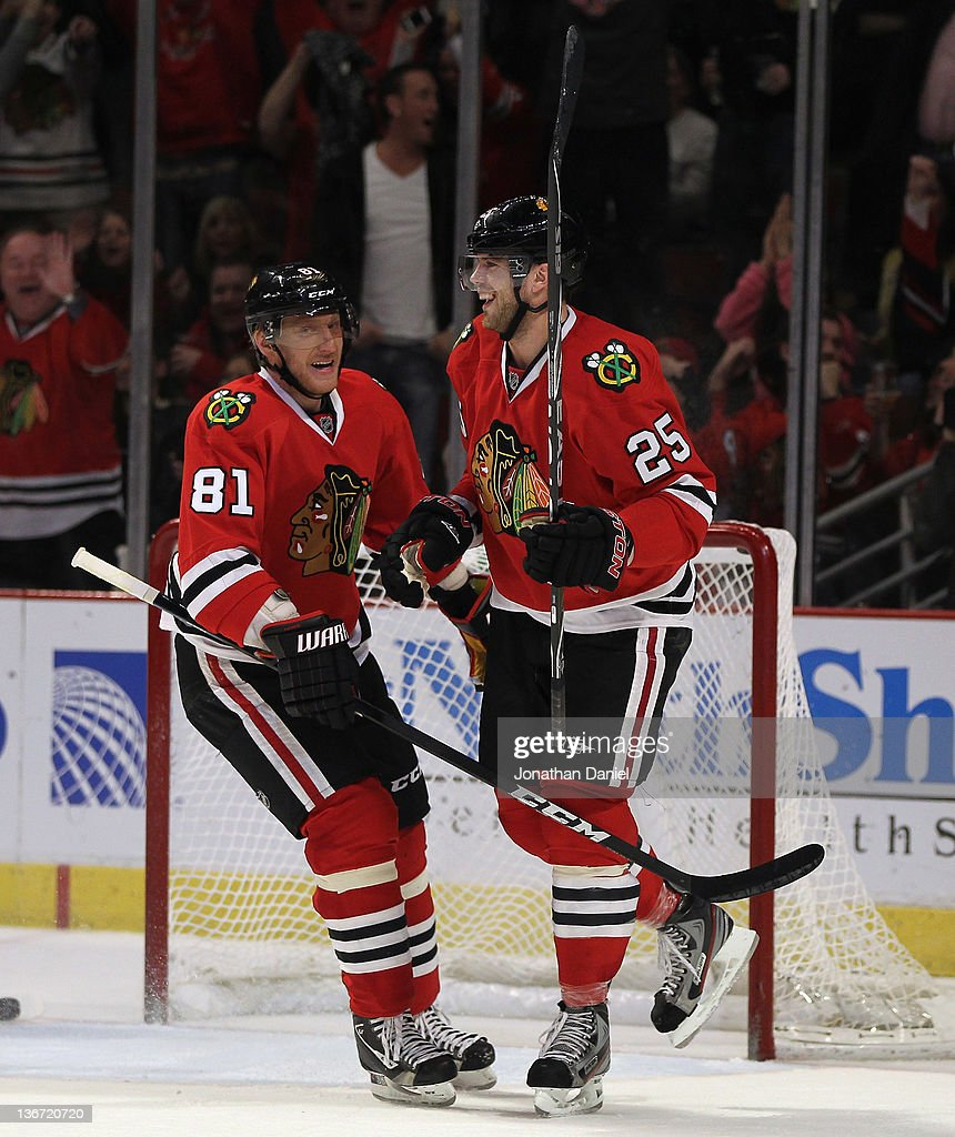 <a gi-track='captionPersonalityLinkClicked' href=/galleries/search?phrase=Viktor+Stalberg&family=editorial&specificpeople=5802237 ng-click='$event.stopPropagation()'>Viktor Stalberg</a> #25 of the Chicago Blackhawks smiles at teammate <a gi-track='captionPersonalityLinkClicked' href=/galleries/search?phrase=Marian+Hossa&family=editorial&specificpeople=202233 ng-click='$event.stopPropagation()'>Marian Hossa</a> #81 after scoring a hat-trick against the Columbus Blue Jackets at the United Center on January 10, 2012 in Chicago, Illinois. The Blackhawks defeated the Blue Jackets 5-2.