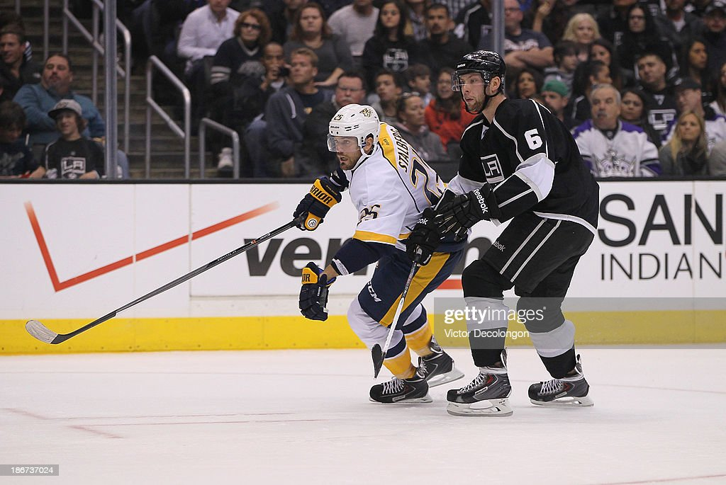 <a gi-track='captionPersonalityLinkClicked' href=/galleries/search?phrase=Viktor+Stalberg&family=editorial&specificpeople=5802237 ng-click='$event.stopPropagation()'>Viktor Stalberg</a> #25 of the Nashville Predators and <a gi-track='captionPersonalityLinkClicked' href=/galleries/search?phrase=Jake+Muzzin&family=editorial&specificpeople=7205557 ng-click='$event.stopPropagation()'>Jake Muzzin</a> #6 of the Los Angeles Kings follow the play up ice during the NHL game at Staples Center on November 2, 2013 in Los Angeles, California. The Predators defeated the Kings 4-3.