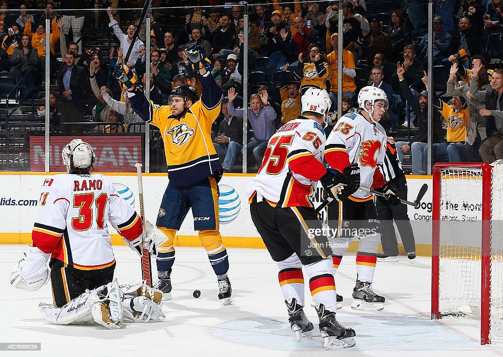 <a gi-track='captionPersonalityLinkClicked' href=/galleries/search?phrase=Viktor+Stalberg&family=editorial&specificpeople=5802237 ng-click='$event.stopPropagation()'>Viktor Stalberg</a> #25 of the Nashville Predators celebrates his goal against <a gi-track='captionPersonalityLinkClicked' href=/galleries/search?phrase=Karri+Ramo&family=editorial&specificpeople=716721 ng-click='$event.stopPropagation()'>Karri Ramo</a> #31 of the Calgary Flames at Bridgestone Arena on January 14, 2014 in Nashville, Tennessee.