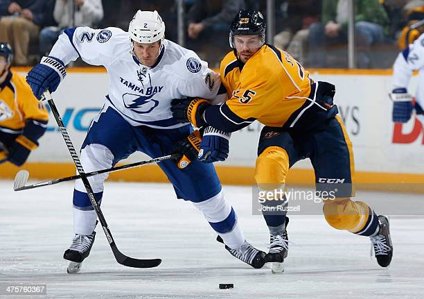 Viktor Stalberg of the Nashville Predators skates against Eric Brewer of the Tampa Bay Lightning at Bridgestone Arena on February 27 2014 in...
