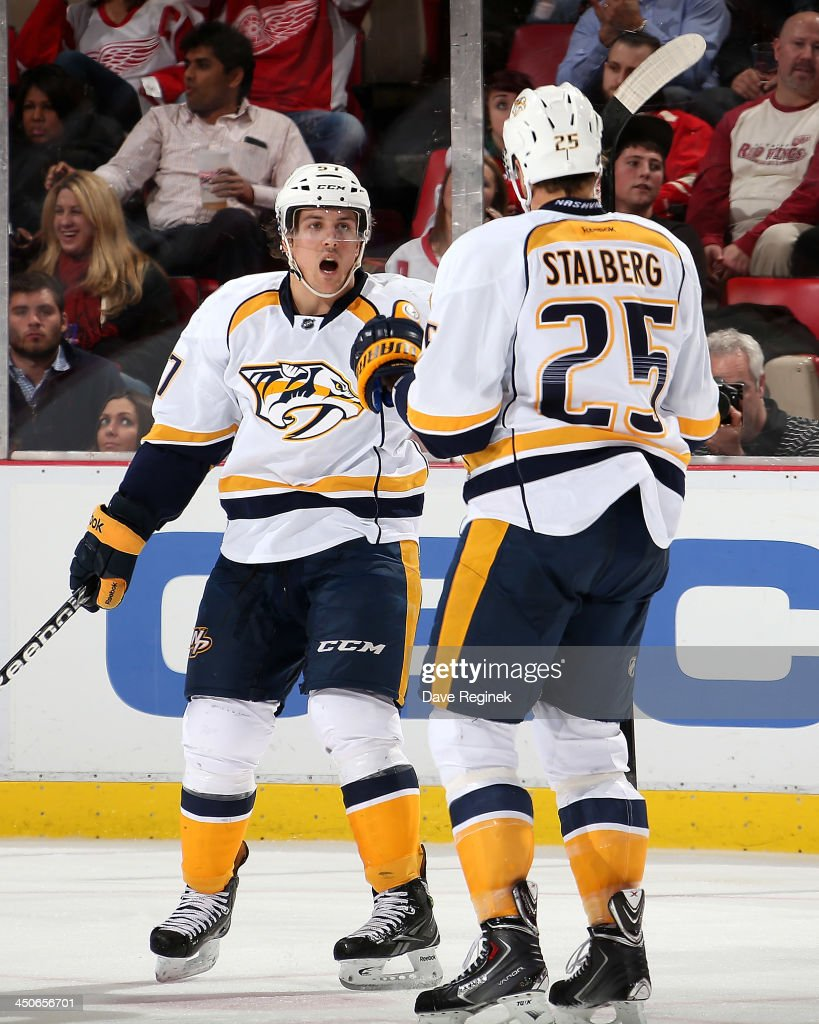 <a gi-track='captionPersonalityLinkClicked' href=/galleries/search?phrase=Viktor+Stalberg&family=editorial&specificpeople=5802237 ng-click='$event.stopPropagation()'>Viktor Stalberg</a> #25 of the Nashville Predators skates over to celebrate with teammate <a gi-track='captionPersonalityLinkClicked' href=/galleries/search?phrase=Gabriel+Bourque&family=editorial&specificpeople=5627917 ng-click='$event.stopPropagation()'>Gabriel Bourque</a> #57 of the Nashville Predators for scoring a goal during an NHL game against the Detroit Red Wings at Joe Louis Arena on November 19, 2013 in Detroit, Michigan. Nashville defeated Detroit 2-0