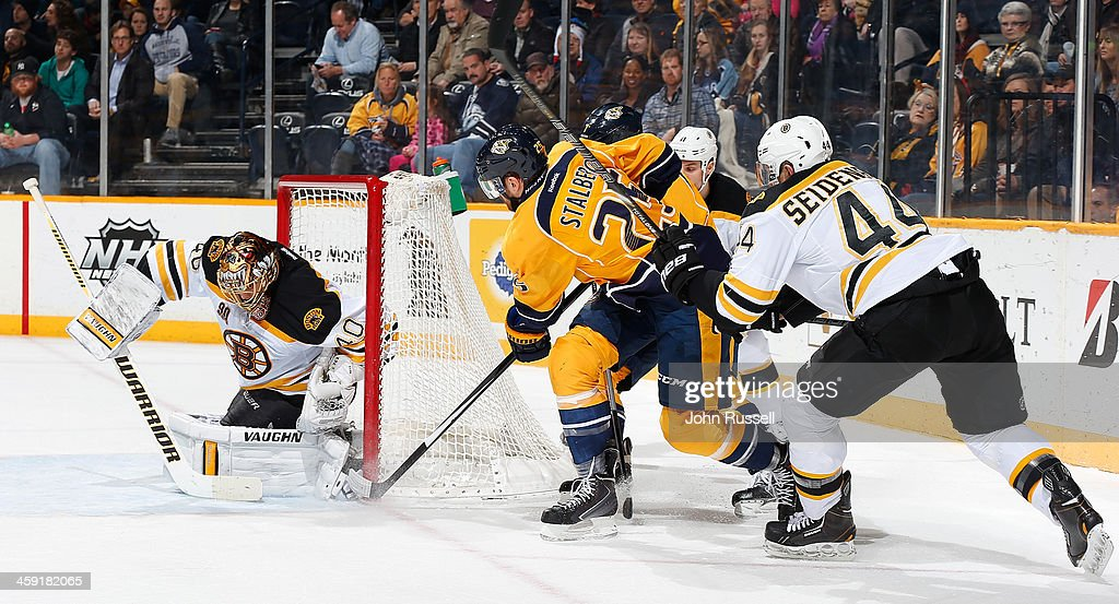 <a gi-track='captionPersonalityLinkClicked' href=/galleries/search?phrase=Viktor+Stalberg&family=editorial&specificpeople=5802237 ng-click='$event.stopPropagation()'>Viktor Stalberg</a> #25 of the Nashville Predators tries a wrap around shot against <a gi-track='captionPersonalityLinkClicked' href=/galleries/search?phrase=Tuukka+Rask&family=editorial&specificpeople=716723 ng-click='$event.stopPropagation()'>Tuukka Rask</a> #40 of the Boston Bruins at Bridgestone Arena on December 23, 2013 in Nashville, Tennessee.