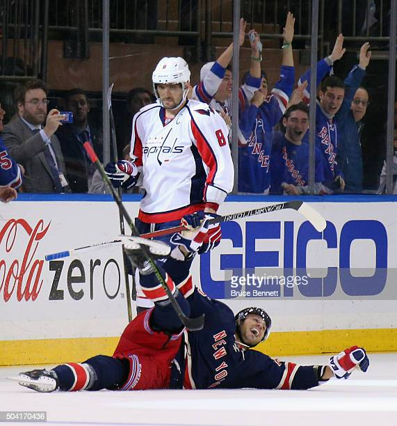 Viktor Stalberg of the New York Rangers celebrates his third period goal against the Washington Capitals as Alex Ovechkin skate by at Madison Square...