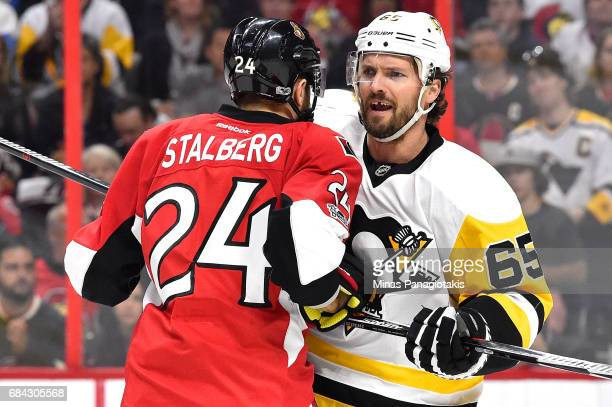 Viktor Stalberg of the Ottawa Senators argues with Ron Hainsey of the Pittsburgh Penguins during the first period in Game Three of the Eastern...