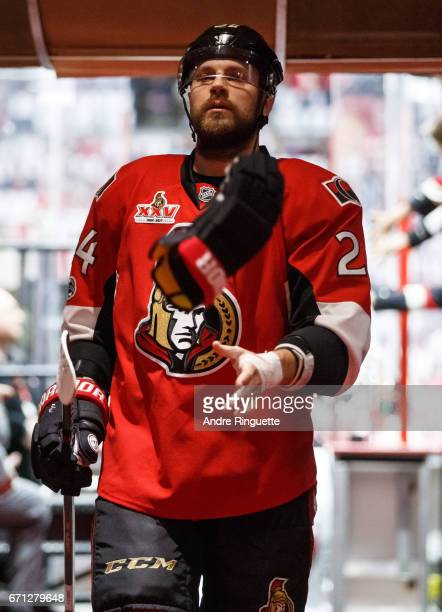 Viktor Stalberg of the Ottawa Senators flips a glove to a trainer as he walks down the players' tunnel after warmup prior to playing against the...
