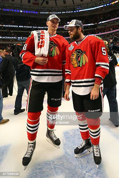 Viktor Svedberg and David Rundblad of the Chicago Blackhawks celebrate after defeating the Tampa Bay Lightning by a score of 20 in Game Six to win...