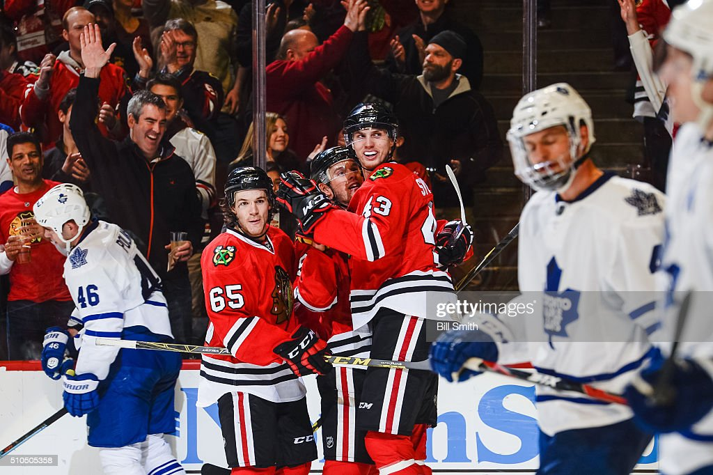 <a gi-track='captionPersonalityLinkClicked' href=/galleries/search?phrase=Viktor+Svedberg&family=editorial&specificpeople=11386489 ng-click='$event.stopPropagation()'>Viktor Svedberg</a> #43 of the Chicago Blackhawks (right) celebrates with <a gi-track='captionPersonalityLinkClicked' href=/galleries/search?phrase=Jonathan+Toews&family=editorial&specificpeople=537799 ng-click='$event.stopPropagation()'>Jonathan Toews</a> #19 and <a gi-track='captionPersonalityLinkClicked' href=/galleries/search?phrase=Andrew+Shaw+-+Joueur+de+hockey+sur+glace&family=editorial&specificpeople=10568695 ng-click='$event.stopPropagation()'>Andrew Shaw</a> #65 after scoring in the third period of the NHL game against the Toronto Maple Leafs at the United Center on February 15, 2016 in Chicago, Illinois.
