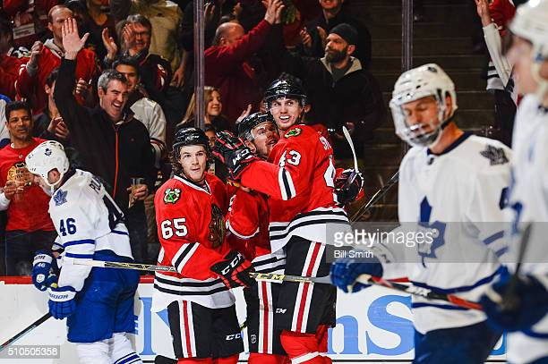 Viktor Svedberg of the Chicago Blackhawks celebrates with Jonathan Toews and Andrew Shaw after scoring in the third period of the NHL game against...