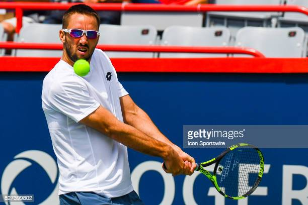 Viktor Troicki makes eye contact with the ball before returning it during his first round match at ATP Coupe Rogers on August 7 at Uniprix Stadium in...