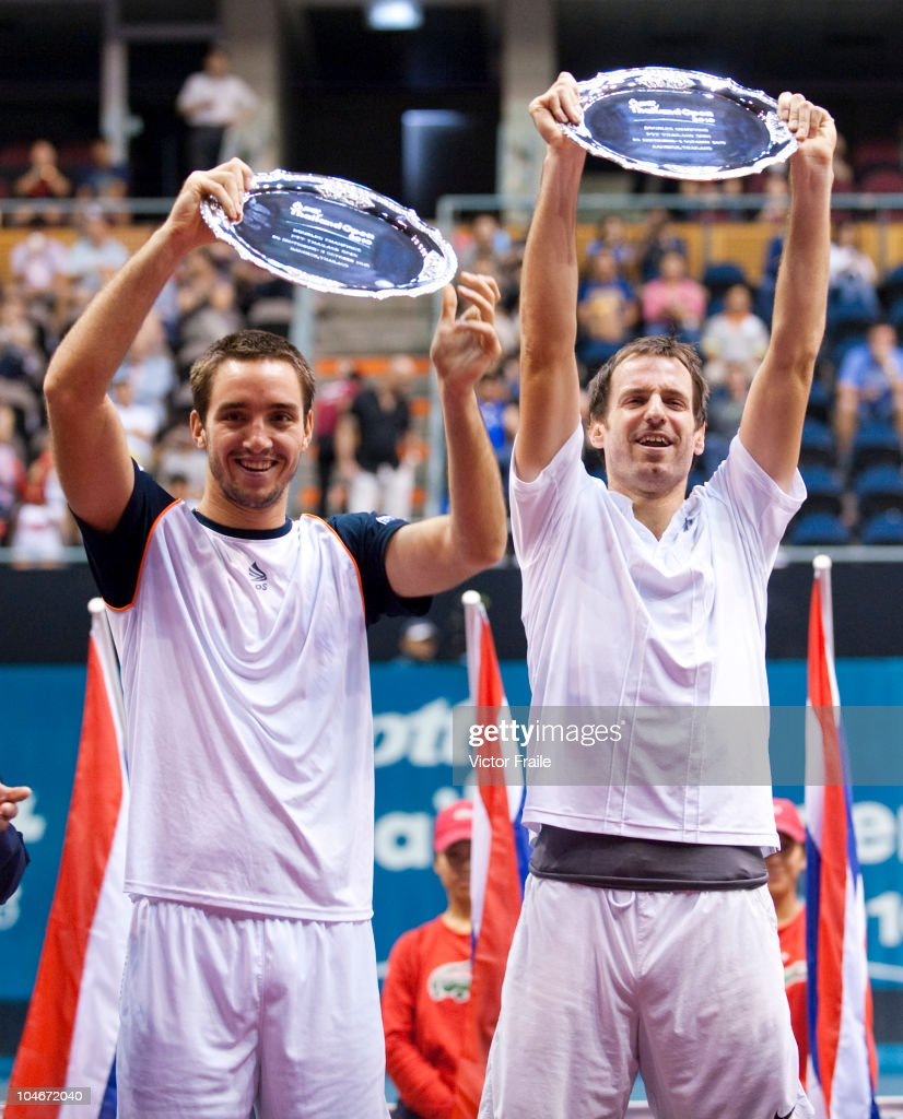 Viktor Troicki of Serbia and Christopher Kas of Germany pose with the trophy after victory in their doubles match against Jonathan Erlich of Israel and Jurgen Melzer of Austria during the Day 9 of the PTT Thailand Open at Impact Arena on October 3, 2010 in Bangkok, Thailand.