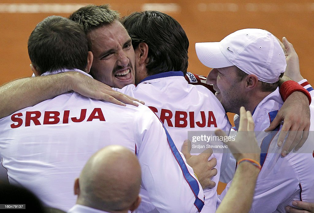 Viktor Troicki (C) of Serbia celebrate victory against David Goffin of Belgium with team mates after the Davis Cup singles first round match between Belgium and Serbia, at Spirou dome February 01, 2013 in Charleroi, Belgium.
