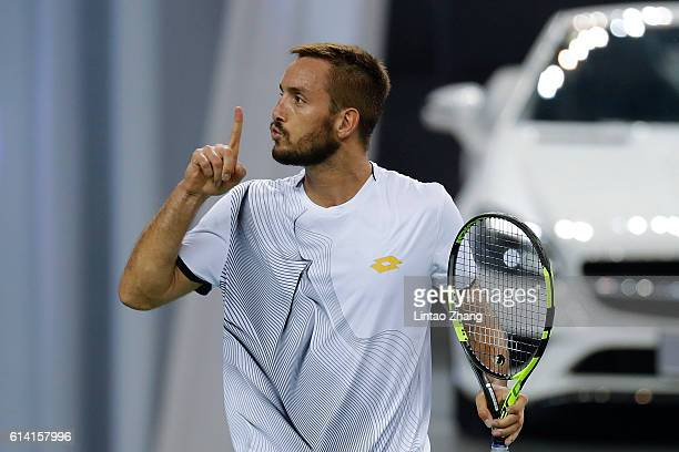 Viktor Troicki of Serbia celebrates after win over Rafael Nadal of Spain during the Men's singles second round match on day four of Shanghai Rolex...