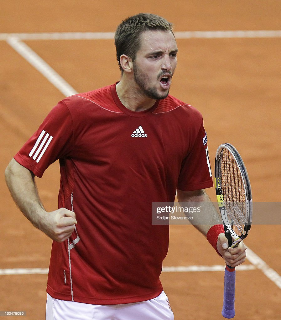 Viktor Troicki (C) of Serbia celebrates victory against David Goffin of Belgium after the Davis Cup singles first round match between Belgium and Serbia, at Spirou dome February 01, 2013 in Charleroi, Belgium.
