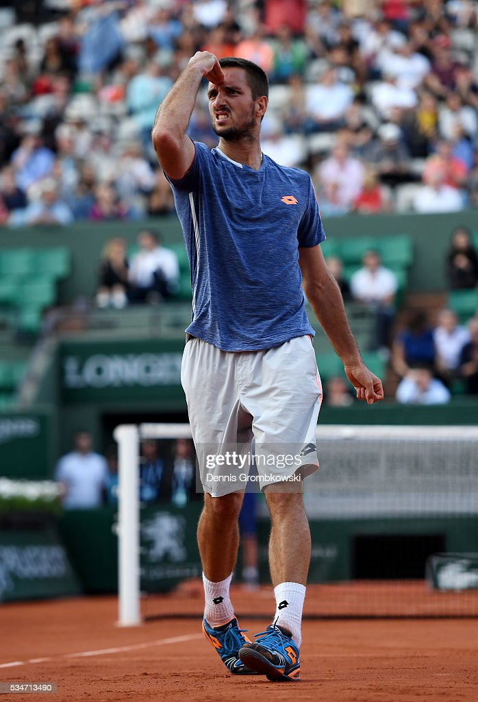 Viktor Troicki of Serbia celebrates victory during the Men's Singles third round match against Gilles Simon of France on day six of the 2016 French Open at Roland Garros on May 27, 2016 in Paris, France.