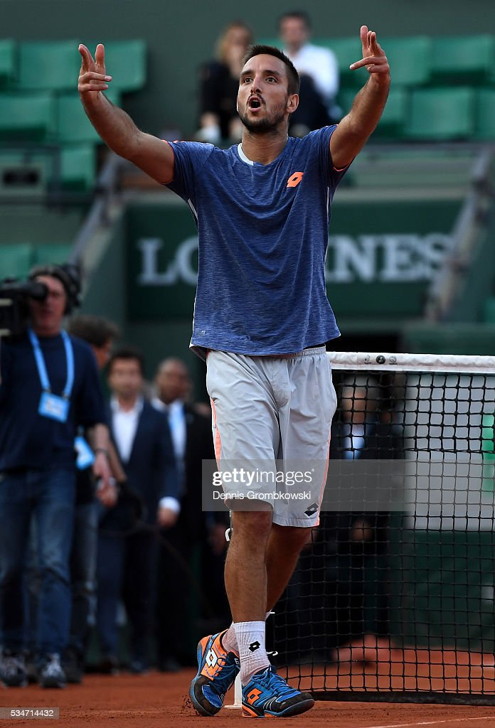<a gi-track='captionPersonalityLinkClicked' href=/galleries/search?phrase=Viktor+Troicki&family=editorial&specificpeople=553829 ng-click='$event.stopPropagation()'>Viktor Troicki</a> of Serbia celebrates victory during the Men's Singles third round match against Gilles Simon of France on day six of the 2016 French Open at Roland Garros on May 27, 2016 in Paris, France.