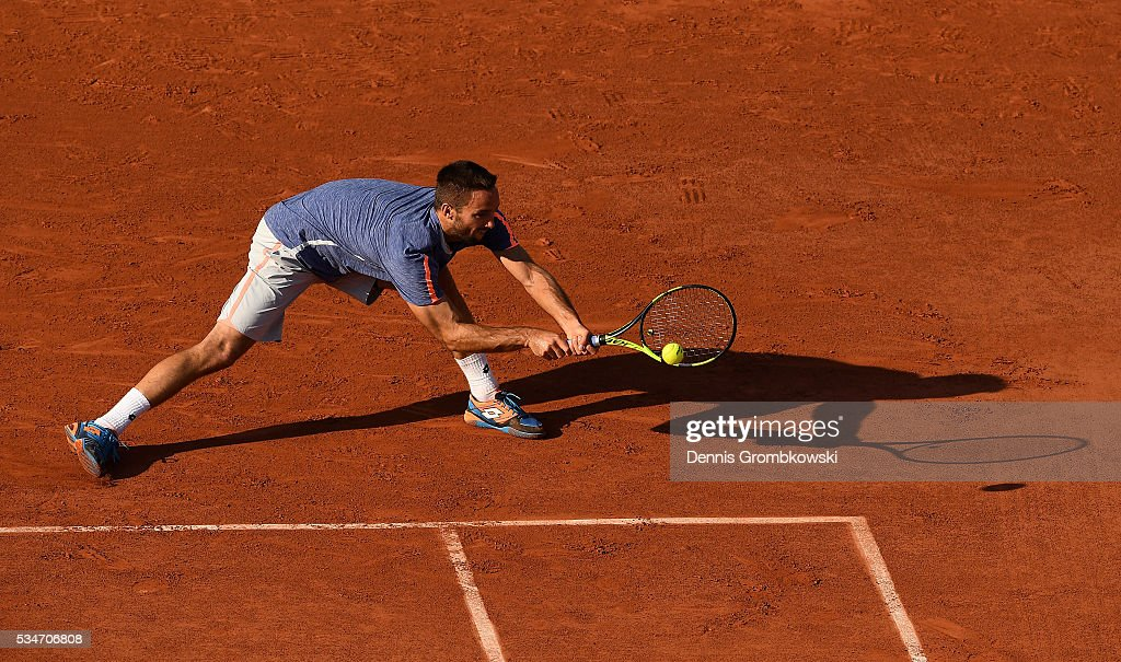 <a gi-track='captionPersonalityLinkClicked' href=/galleries/search?phrase=Viktor+Troicki&family=editorial&specificpeople=553829 ng-click='$event.stopPropagation()'>Viktor Troicki</a> of Serbia hits a backhand during the Men's Singles third round match against Gilles Simon of France on day six of the 2016 French Open at Roland Garros on May 27, 2016 in Paris, France.