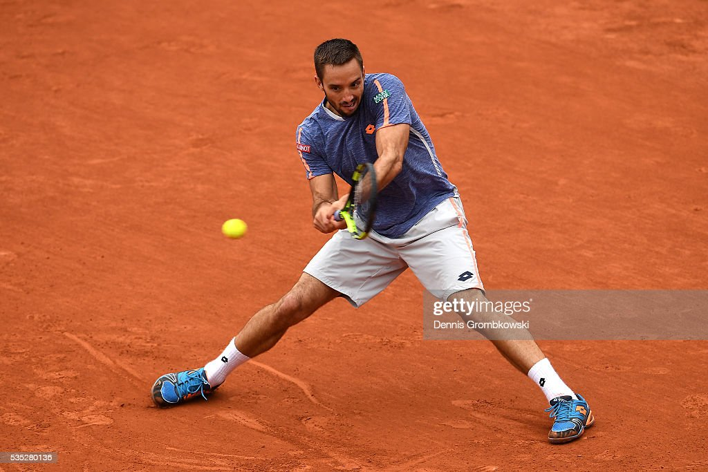 <a gi-track='captionPersonalityLinkClicked' href=/galleries/search?phrase=Viktor+Troicki&family=editorial&specificpeople=553829 ng-click='$event.stopPropagation()'>Viktor Troicki</a> of Serbia hits a backhand during the Men's Singles fourth round match against Stan Wawrinka of Switzerland on day eight of the 2016 French Open at Roland Garros on May 29, 2016 in Paris, France.