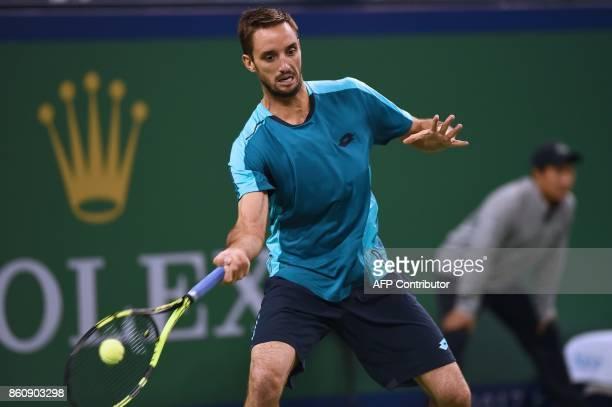 Viktor Troicki of Serbia hits a return during the men's quarterfinals singles match against Juan Martin del Potro of Argentina at the Shanghai...