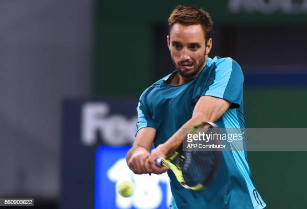 Viktor Troicki of Serbia hits a return during the men's quarterfinals singles match against Juan Martin del Potro of Argentina at the Shanghai...