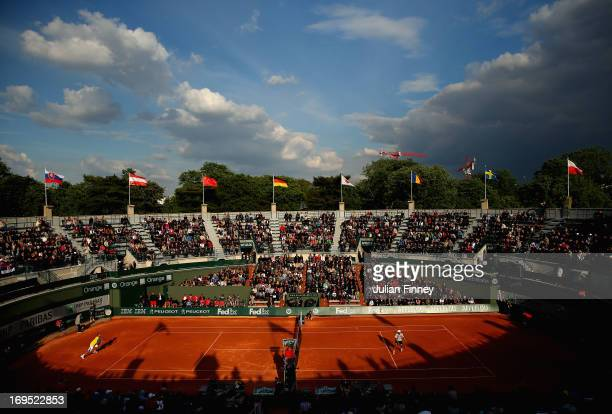 Viktor Troicki of Serbia in action against James Blake of the United States during their men's singles match on Court 1 during day one of the French...