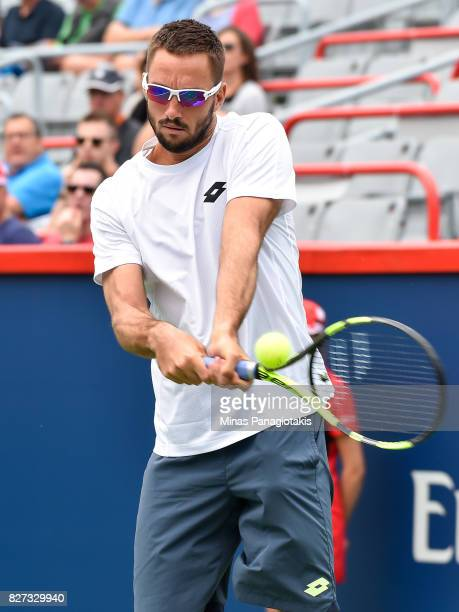 Viktor Troicki of Serbia Montenegro hits a return against Nick Kyrgios of Australia during day four of the Rogers Cup presented by National Bank at...