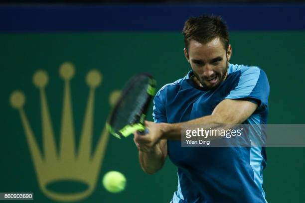 Viktor Troicki of Serbia plays a backhand during the Men's singles quarter final mach against Juan Martin del Potro of Argentina on day six of 2017...