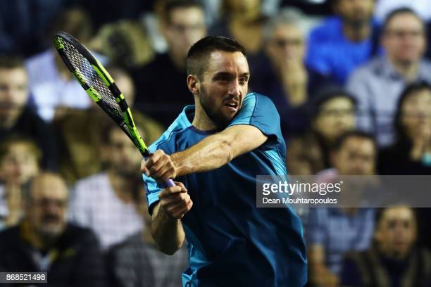 Viktor Troicki of Serbia plays a forehand against Diego Schwartzman of Argentina during Day 2 of the Rolex Paris Masters held at the AccorHotels...