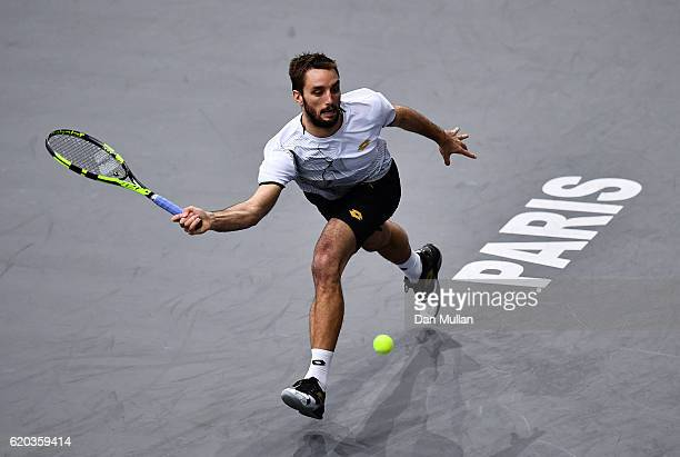 Viktor Troicki of Serbia plays a forehand against Kei Nishikori of Japan during the Mens Singles second round match on day three of the BNP Paribas...