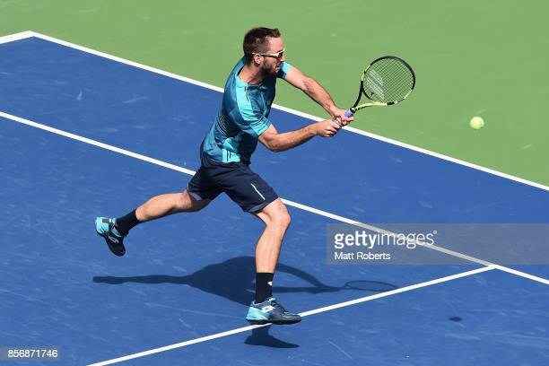 Viktor Troicki of Serbia plays a forehand against Milos Raonic of Canada during day two of the Rakuten Open at Ariake Coliseum on October 3 2017 in...