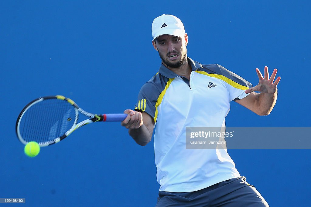 Viktor Troicki of Serbia plays a forehand in his first round match against Radek Stepanek of the Czech Republic during day one of the 2013 Australian Open at Melbourne Park on January 14, 2013 in Melbourne, Australia.