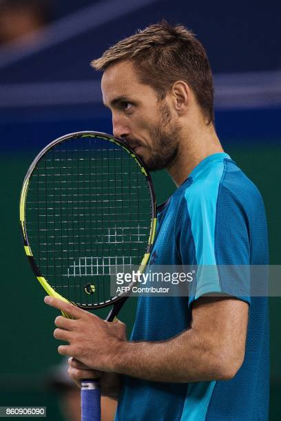 Viktor Troicki of Serbia reacts after losing a point during his men's quarterfinals singles match against Juan Martin Del Porto of Argentina at the...
